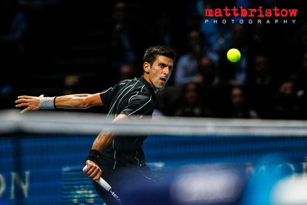 Barclays ATP World Finals - Novak Djokovic drops a shot just over the net.