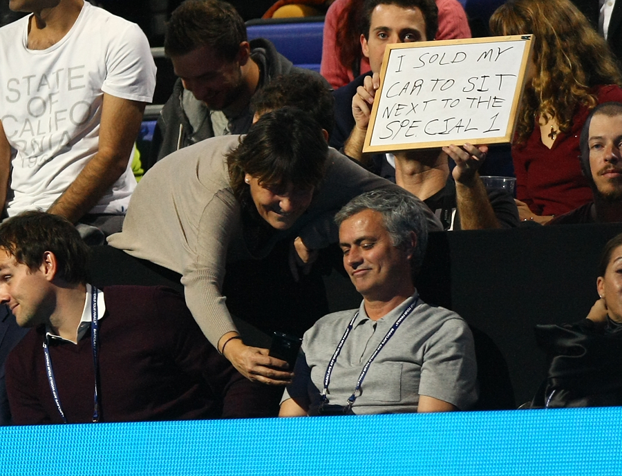 José Mourinho has his picture taken with a fan.